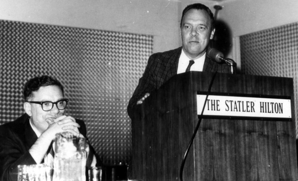 Hal Clement (Isaac Asimov seated) speaks at one of the early editions of Boksone - a Science Fiction convention held in the Boston area to this day (photo uncredited, from 1966)