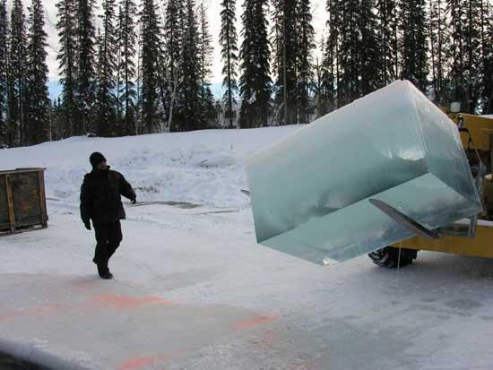 Strachan alongside his ice block in Alaska (photo courtesy the artist and Pierogi2000 Gallery)