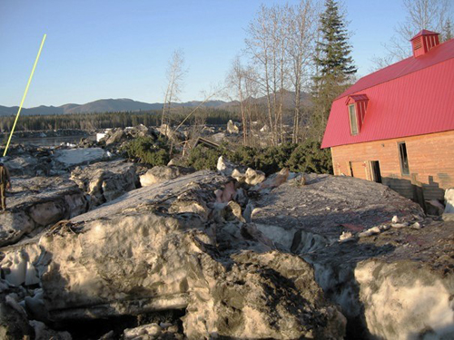 A house in Eagle twisted off its foundation by May's ice floes (photo www.themudflats.net)